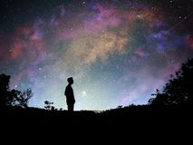 Man standing. Milky Way background royalty free stock image