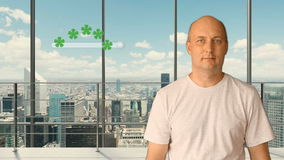 A man standing in a modern office with panoramic windows sets a rating on a virtual screen. Service rating 5 stars. Future technologies. City skyline outside stock footage