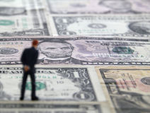 Man Standing on a Money Floor. Blurred man standing on a floor made of money Stock Photography