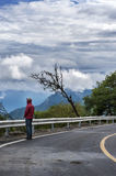 A man standing by the mountain road Royalty Free Stock Photography