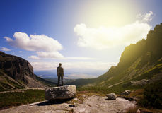 Man standing at the mountain top Stock Photo