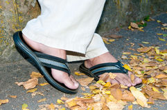 Man standing in my flip-flops Royalty Free Stock Image