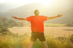Man standing in nature with arms outstretched Royalty Free Stock Photography