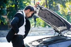 Man standing near broken car royalty free stock photo