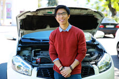 Man standing near car with bonnet open Royalty Free Stock Photo