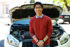Man standing near car with bonnet open Royalty Free Stock Photos