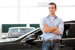 Man standing near a car Royalty Free Stock Image