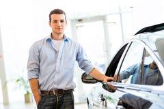Man standing near a car Stock Photos