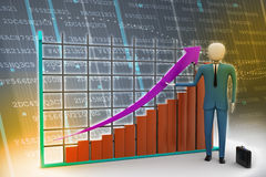 Man standing near a financial graph Royalty Free Stock Photo
