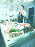 Man standing near fish Stock Images