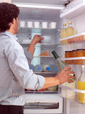 Man standing near freezer l Stock Photos