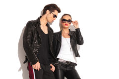 Man standing near his girlfriend wearing leather jacket Stock Images