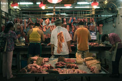 Man Standing Near Meat Shop in the Marker Royalty Free Stock Photography