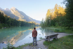 Man standing near the mountain lake royalty free stock images