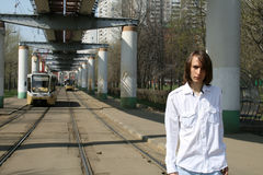 Man standing near trams Royalty Free Stock Images