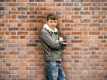Man standing near the wall Stock Images