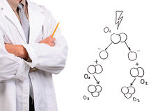 Man standing next to a drawing. Man in a white lab coat standing with his arms crossed next to a drawing of the ozone formation stock images