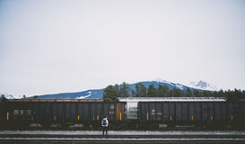 Man Standing  Next To A Railroad