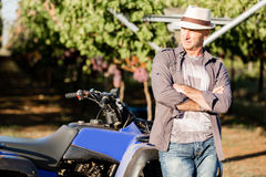 Man standing next to truck in vineyard. Man wearing hat standing next to truck in vineyard Royalty Free Stock Photography