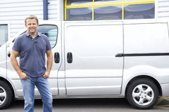 Man standing next to van Stock Photo
