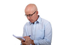 Man standing with a notebook Stock Photo