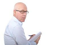 Man standing with a notebook Royalty Free Stock Photo