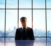 Man standing in office Stock Images