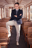 Man standing in an old train wooden wagon or carriage and lookin Royalty Free Stock Photography