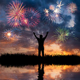 A man looks holiday fireworks Stock Images