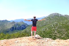 Man standing with open hands in front of the mountains at Lakonia Peloponnese Greece Royalty Free Stock Photo