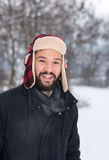 Man standing outdoors while it is snowing Royalty Free Stock Photos