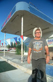 A man standing outside an abandoned gas station Royalty Free Stock Photography