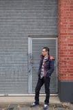Man standing outside garage door stock photo