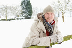 Man Standing Outside In Snowy Landscape Stock Images
