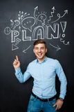 Man standing over blackboard with a plan concept. point above Stock Images
