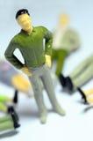 Man standing over lying figures Stock Image