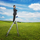 Man standing on the pair of steps Royalty Free Stock Photos