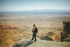 Man Standing on Peak Stock Images