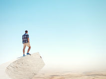Man standing on a peak and desert Stock Image