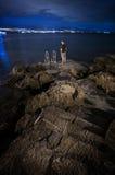 Man standing at pier at night in Opatija, Croatia Stock Photos