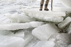 Man standing on pile of ice Royalty Free Stock Photos