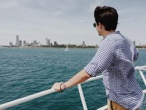 Man Standing on Powerboat and Looking on Body of Water during Daytime Royalty Free Stock Photography