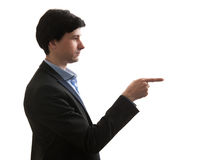 Man standing in profile and pointing finger Royalty Free Stock Images