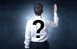 Man standing with question mark on his back Stock Images