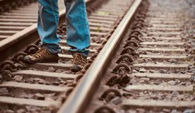 Man standing in a rail tracks unique stock photo stock image
