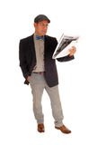 Man standing and reading the newspaper. Royalty Free Stock Image