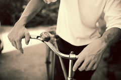 Man standing with retro bicycle Stock Images