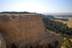 Man Standing on the Ridge at Fort Robinson State Park, Nebraska. A man Standing on the Ridge at Fort Robinson State Park, Nebraska Royalty Free Stock Photos