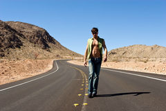 Man standing on the road Royalty Free Stock Image