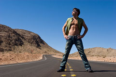 Man standing on the road Stock Photography
